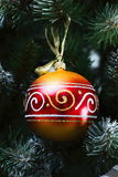 Decorative ball on the Christmas tree Stock Images