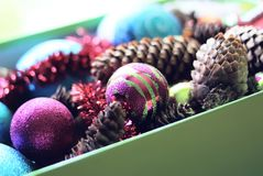 Decorative balls and fir-tree cones close up. Decorative christmas balls and fir-tree cones close up Stock Photo