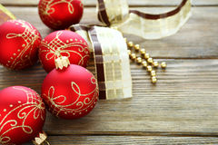Decorative balls with ribbon on the boards Royalty Free Stock Photo