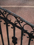 Decorative banister and wall. Decorative banister or railing by a brick wall stock photos