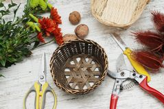 Decorative bascket and tools for creating the bouquet and greeting card on the desktop. Florist work space or table. stock image