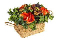Decorative basket with artificial flowers royalty free stock image