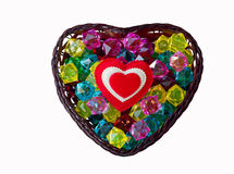 Decorative basket as heart with colored glass. And a red heart Royalty Free Stock Images