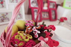 Decorative basket. Crocheted flowers in a basket Royalty Free Stock Image