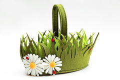 Decorative basket of felt in the form of grass and flowers Royalty Free Stock Images