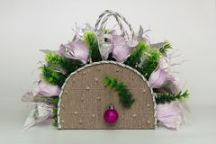 Decorative basket with paper lilies and christmas ball Stock Photos