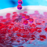 Decorative beads in a spray of water Stock Images