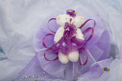 Decorative bears to decorate. Purple and placed on a white organza fabric Royalty Free Stock Images