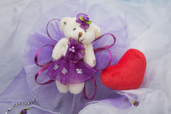 Decorative bears to decorate. Purple and placed on a white organza fabric Stock Photography