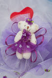 Decorative bears to decorate. Purple and placed on a white organza fabric Royalty Free Stock Photo