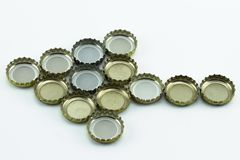 Decorative beer caps on white background. Metal cover from glass bottles. stock images