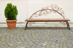 Decorative bench and flower pot Stock Images