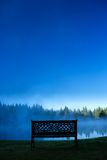 A decorative bench in front of a foggy pond, Stowe Vermont, USA Stock Images