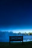 A decorative bench in front of a foggy pond, Stowe Vermont, USA Royalty Free Stock Photography