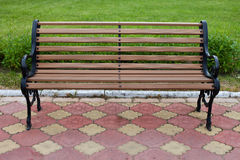 Decorative bench in garden park. Green grass background. Front view Stock Photos