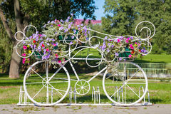 Decorative bicycle carrying flowers Stock Photo