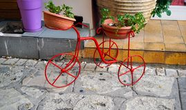 Decorative bicycle. Decorative metal bicycle with pots of colorful flowers stock image