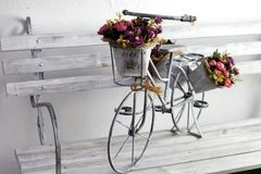 Decorative bicycle with flowers made of metal and painted in silver royalty free stock images