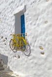 Decorative bicycle hanging from a window in a Greek house Stock Photos