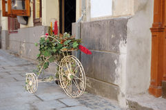 Decorative bicycle. Stands near a wall on the street Stock Image