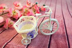 Decorative bicycle from a vine with flowers stock images
