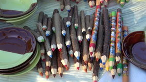 Decorative big wooden pencils in market stock video footage