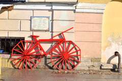 Decorative bike on a city street. ST.PETERSBURG, RUSSIA - 15 APRIL 2017: Decorative red bike on a city street in center of St.Petersburg Stock Images