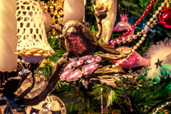Decorative bird on branch. Christmas tree background royalty free stock photography