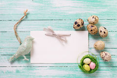 Decorative bird,  Easter eggs and empty tag on wooden background Stock Image