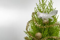 Decorative bird with ornaments on a Christmas pine royalty free stock images