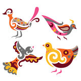 Decorative Birds. Set of four bird ornaments in bright colors Stock Images
