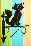 Decorative black cat. Decorative black cat on the colorful surface Stock Photo