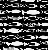 Decorative black and white pattern with fish. Seamless marine background. Grunge fabric texture Stock Images