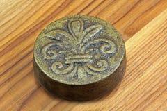 Decorative blazon. Decorative bronze blazon badge on wooden background Royalty Free Stock Photography