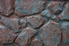 Decorative blue red stone fence with cracks stock images