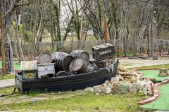 Decorative boat full of crate and barrel on a mini golf. Decorative boat full of crate and barrel on a mini golf Royalty Free Stock Image