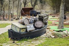 Decorative boat full of crate and barrel on a mini golf.