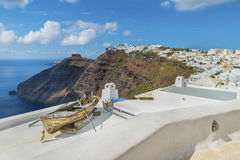 Decorative boat on the roof of a traditional Greek house at Fira town. Santorini ( Thira ) island Stock Photography