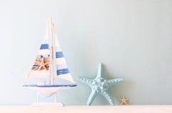 Decorative boat and seashell Stock Photography