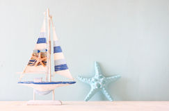Decorative boat and seashell. Stock Images