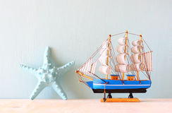 Decorative boat and seashell Stock Photos