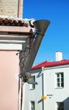 Decorative boot-shaped drainpipe in Tallinn Stock Images