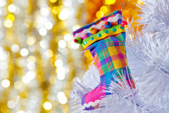 Decorative boots on a white Christmas tree. Royalty Free Stock Photography