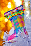 Decorative boots on a white Christmas tree. Royalty Free Stock Photos
