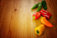 Peppers on wooden background Stock Image