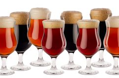 Decorative border of different beer in goblet with foam - lager, red ale, porter - isolated on white background, copy space. stock photography