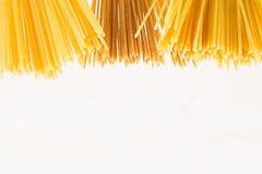 Decorative border of tips kinds italian spaghetti isolated on white background. Stock Image