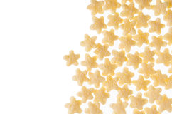 Decorative border of yellow stars corn flakes isolated on white background. Stock Image