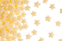 Decorative border of yellow stars corn flakes isolated on white background. Copy space, cereals texture. Stock Image