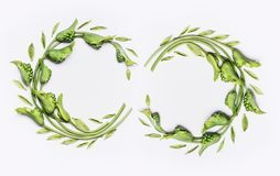 Decorative botanical flower double wreath frames made of green different flowers and leaves, flat lay. Top view on white background stock image